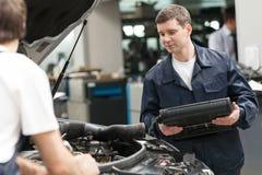 Mechanics at work shop. T Royalty Free Stock Photo