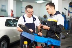 Mechanics at work shop Stock Photo