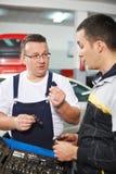Mechanics at work shop Royalty Free Stock Image