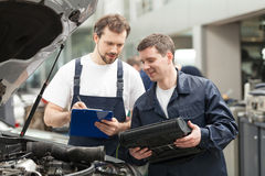 Mechanics at work shop. Stock Image