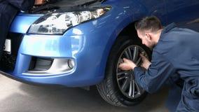 Mechanics working on a car stock footage