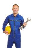 Mechanik w kombinezonie z hełma i szczęki wyrwaniem obrazy stock