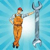 Mechaniker mit einem Schlüssel lizenzfreie abbildung