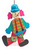 Mechanisch clownstuk speelgoed op koord stock afbeeldingen