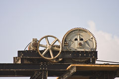 Mechanism. The mechanism of the old port crane on a background of the sky Royalty Free Stock Photo