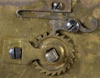 Mechanism of clock. Close-up mechanism of old clock on white Stock Photos