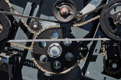Mechanism with cogwheels and belt drives. Mechanism with cogwheels, chain and belt drives Royalty Free Stock Photos
