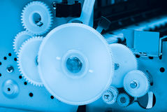 Mechanism with gears blue toning Royalty Free Stock Image