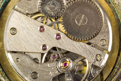 Mechanism of hours close up. Mechanism of a watch macro scale Stock Image
