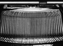 Mechanism of letter bars of type writer. Close up photograph of the mechanism of the letter bars of an antique type writer Royalty Free Stock Images