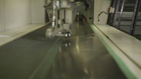 Mechanism Moves Cutting Steel Sheet in Enterprise Closeup. Closeup modern mechanism with cog-wheel moves cutting steel sheet in heavy industry tire enterprise stock video footage