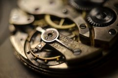 The mechanism of old antique pocket watches, Close up view of old clock`s gears. selective focus.  stock image