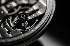 The mechanism of old antique pocket watches, Close up view of old clock`s gears. selective focus.  royalty free stock photography