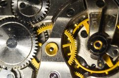 The mechanism of old antique pocket watches, Close up view of old clock`s gears. selective focus.  royalty free stock photos