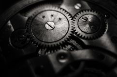 The mechanism of old antique pocket watches, Close up view of old clock`s gears. selective focus.  royalty free stock image