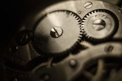 The mechanism of old antique pocket watches, Close up view of old clock`s gears. selective focus.  stock photography