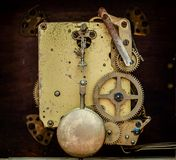 The mechanism of the old clock. With the door open Royalty Free Stock Photos