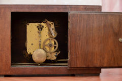 The mechanism of the old clock. With the door open Stock Images