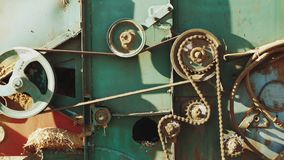 The mechanism of the old combine in the work of close-up. Chain and gear form some machine stock video footage