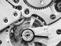 Mechanism of old watch in black and white stock photos
