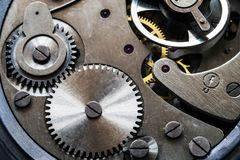 Mechanism of old mechanical watches with a pendulum, gears and other details stock photos
