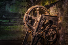 The mechanism of a old and vintage winch Stock Photos