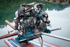Mechanism of the outboard motor. Outdoor gear motor boats parked on the lake stock images