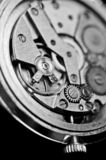 Mechanism of wrist watches in the clear. Shallow depth of field. Mechanism of wrist watches in the clear closeup. Shallow depth of field stock photo
