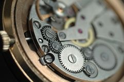 Mechanism of wrist watches in the clear. Shallow depth of field royalty free stock photography