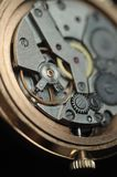 Mechanism of wrist watches in the clear. Shallow depth of field. Mechanism of wrist watches in the clear closeup. Shallow depth of field stock images