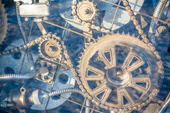Mechanisms. Complex mechanisms, gears, drums and chain in light blue aura Stock Images