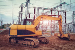 Mechanisms of excavator at  construction site of power station of electricity. Royalty Free Stock Images