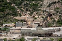 Mechanisms in a gravel pit. Mining processing plant stock photo