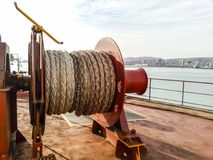 Mechanisms of tension control ropes. Winches. Equipment on the deck of a cargo ship or port.  Stock Photos