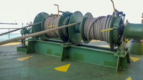 Mechanisms of tension control ropes. Winches. Equipment on the deck of a cargo ship or port Stock Image