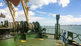 Mechanisms of tension control ropes. Winches. Equipment on the deck of a cargo ship or port Stock Images