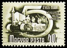 Mechanized agriculture, Five-Year Plan serie, circa 1950. MOSCOW, RUSSIA - MARCH 23, 2019: Postage stamp printed in Hungary shows Mechanized agriculture, Five royalty free stock photos