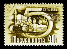 Mechanized agriculture, Five-Year Plan serie, circa 1950. MOSCOW, RUSSIA - MAY 16, 2018: A stamp printed in Hungary shows Mechanized agriculture, Five-Year Plan stock image