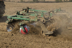 Mechanized loosening the soil tractor Royalty Free Stock Photo