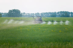 Mechanized processing fields fertilization Royalty Free Stock Photo