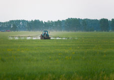 Mechanized processing fields fertilization Stock Photos