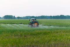 Mechanized processing fields fertilization Royalty Free Stock Photography