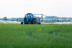 Mechanized processing fields fertilization Stock Image