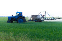Mechanized processing fields fertilization Stock Photo