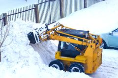 Mechanized snow cleaning compact road equipment. royalty free stock photos