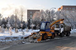 Mechanized snow removal. After a snowfall royalty free stock photography