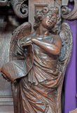 Mechelen - χαρασμένο άγαλμα αγγέλου με την επιγραφή Inri από την εκκλησία onze-Lieve-Vrouw ν-Hanswijkbasiliek Στοκ φωτογραφία με δικαίωμα ελεύθερης χρήσης