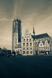 Mechelen, Belgium. The main market square with the St. Rumbold`s cathedral in the background in Mechelen or Malines in Belgium - monochrome Royalty Free Stock Image