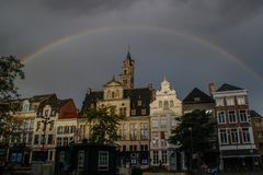 After the storm over the center of the city of Mechelen, a large, beautiful and bright rainbow appeared that surrounded medieval h. Mechelen, Belgium - October 1 stock photos