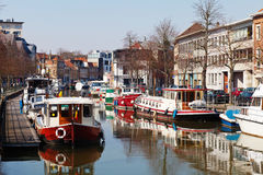 Mechelen boats. Boats parked along the channel in the city of Mechelen (Flanders region, Belgium Stock Photos